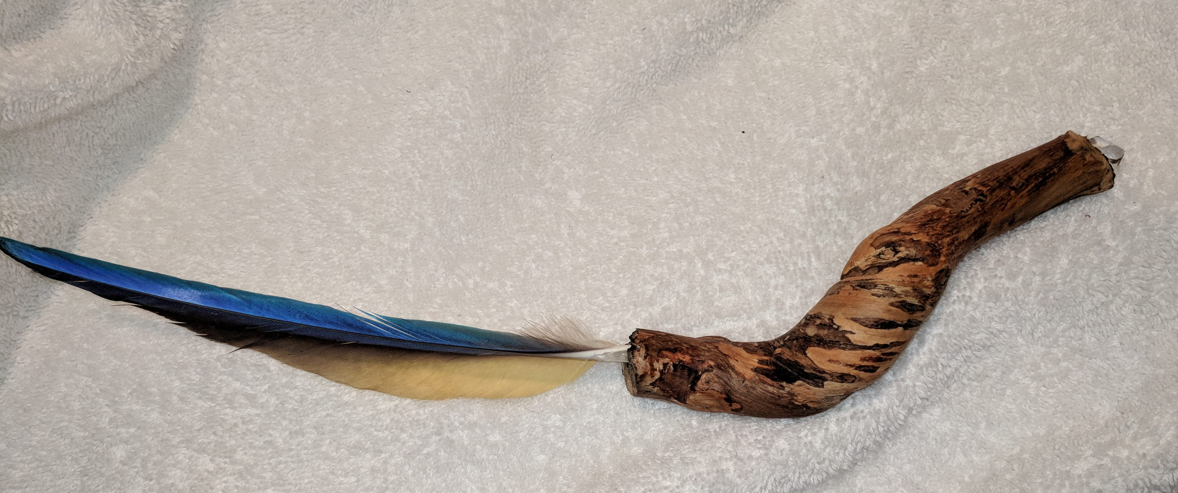Spirit Arrow made from curved grapevine, macaw feather, sinew and quartz crystal